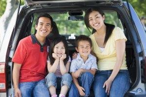 smiling_asian_family_in_van